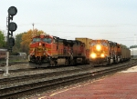 616 passes a stopped train